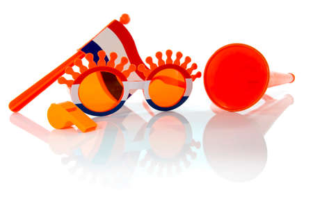 plastic glasses horn flute and flag in orange color and isolated on white photo