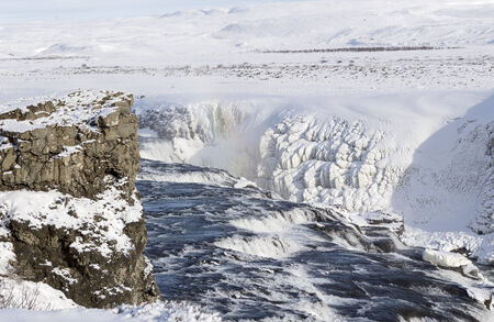 ice and snow in iceland gullfoss waterfall area photo