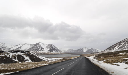 the road to  snaefellsne on the island iceland with lake and mountains in winter photo
