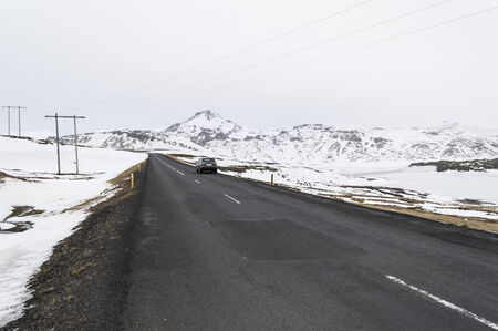 the road to  snaefellsne on the island iceland with mountains in winter photo