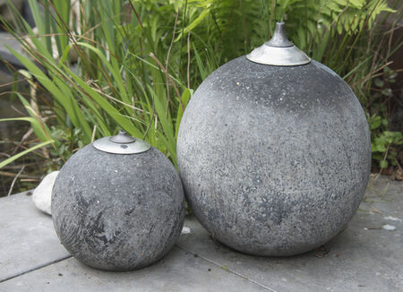 two concrete big oil lamps for outside garden Stock Photo