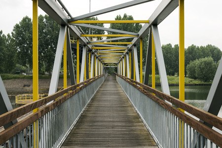 maas: metal bridge crossing the river maas in holland Stock Photo