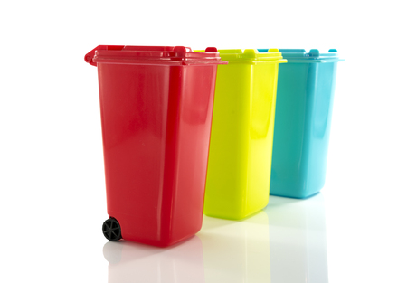 red blue and yellow green garbage bin isolated on white photo