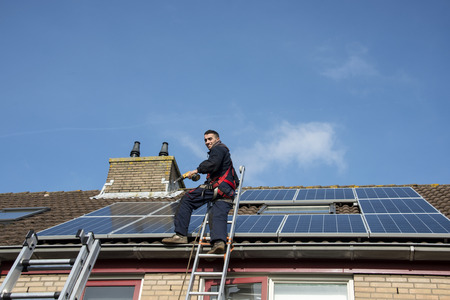 man smiling and happy with construction of solar panels