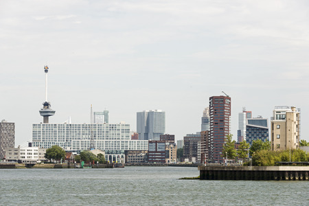 rotterdam dutch city skyline with euromast harbor offices and houses