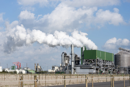 industry with pollution vessels pipes and other equipment in europoort rotterdam photo
