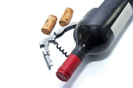 connoisseurs: red wine bottle with cork and corksrew