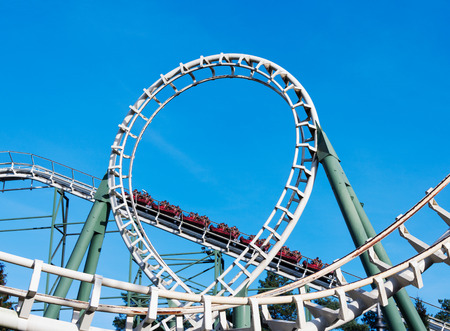 people in roller coaster on amusement park in holland