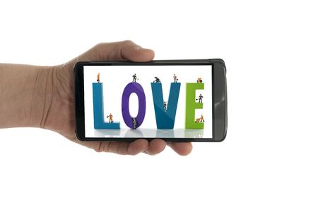 faisant l amour: femme la main avec prise texte d'amour dans le t�l�phone