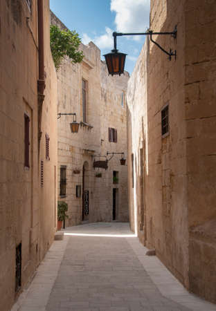 ramping: old street with ligths and amber building on the island malta