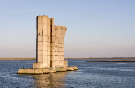one level: a pillar similar to those used for the Dutch Delta Works to protect holland form high sea level, this one is from the dutch museum neeltje jans Stock Photo