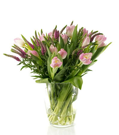 git: boueqt of pink tulips on vase from glass as present or git to girlfriend mother or other love one Stock Photo
