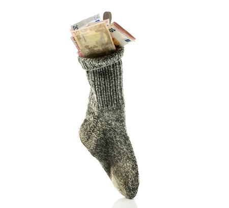 interst: because of the low interst rate people are putting money in a sock to save value Stock Photo