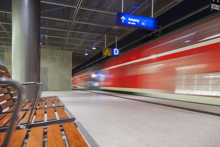 wood railroads: high speed red train crossing trainstation in Berlin Germany Editorial