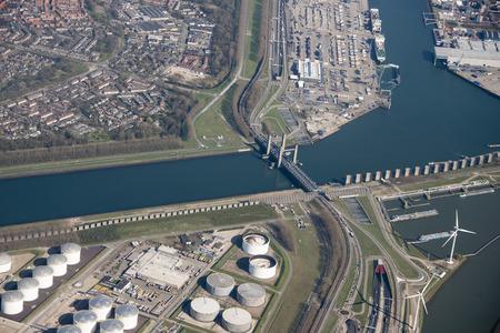europoort oil tanks and the bridge of rozenburg called callandbridge from air plane Foto de archivo