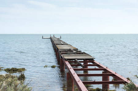 ocea: old rusted urbam quay with broken wooden plank Stock Photo