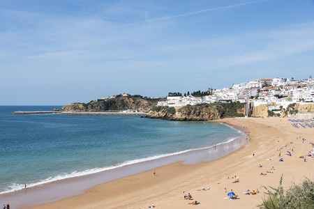 region of algarve: View of crowded Falesia beach at the midday in the summer mediterranean resort Albufeira on April 23, 2015. This town is a part of famous tourist region Algarve.