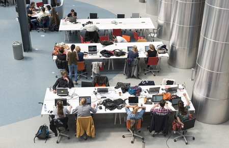 techincal: DELFT HOLLAND APRIL 21: Boys and girls on the techincal university are studying in the auditorium between the lessons on April 21 Delft Holland this is the university in Holland with the biggest industrial design part