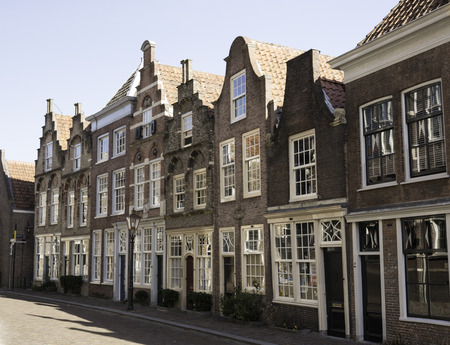 dordrecht: DORDRECHT,NETHERLANDS-FEBRUARY 2 2015. old houses with typivcal dutch village gables like stapped and neck gable in Dordrecht on February 02 2015,this village is already knwo from1200 Editorial