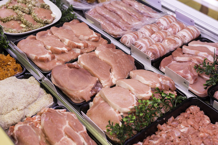 fresh meat like ham bacon sausages and other in buther shop