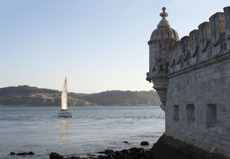 the tagus: schip is sailing on the Tagus river in front of the Belem tower in Lisbon Portugal