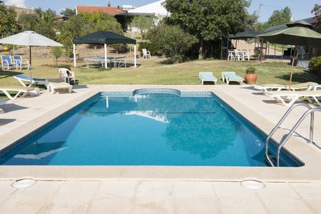 tabel: tropical swimming pool in garden in Portugal Alentejo Editorial