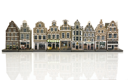 stepped: miniature model houses , shops as in old Amsterdam Holland isolated on white background Stock Photo