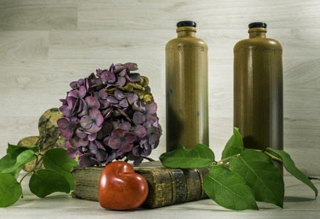 Stil: stil life  with stone bottles on wooden background Stock Photo