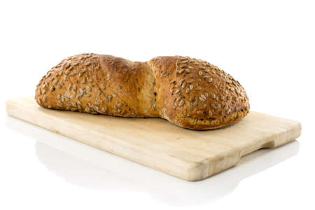 solated on white: homemade fresh bread ion  wooden cutting board solated on white background