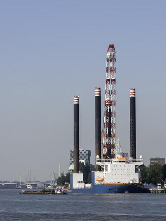 maas: Industrial platfom on the river Maas in Rotterdam harbor Holland