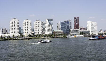 maas: ROTTERDAM,NETHERLANDS- AUGUST 31, 2016: container ship and tourist boats on the river maas with the skyline of rotterdam on August 31 2016 in Rotterdam,this is the biggest port in Holland and also one of the biggest in the world Editorial