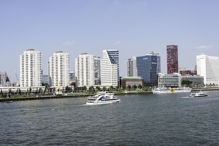 maas: ROTTERDAM,NETHERLANDS- AUGUST 31, 2016: cruise ship on the river maas with the skyline of rotterdam on August 31 2016 in Rotterdam,this is the biggest port in Holland and one of the biggest in the world