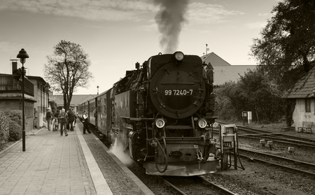 WERNIGERODE,GERMANY, SEPTEMBER 21,2016: Unidentified people entering the steam train for a drive to the mountain in Wernigerode on september 21 2016,The trains to the Brocken mountain operate around the year for tourists.