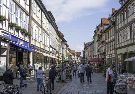 west germany: WERNIGERODE,GERMANY, SEPTEMBER 21,2016: Unidentified people shopping in the streets of Wernigerode on september 21 2016,This village was on the border of east and west Germany before the wall was destreoyed