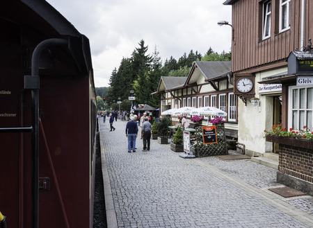 loc: DREI ANNEN HOHNE,GERMANY, SEPTEMBER 22,2016: Unidentified people entering the steamtrain the station on september 22 2016,trains to the Brocken mountain operate around the year. Editorial