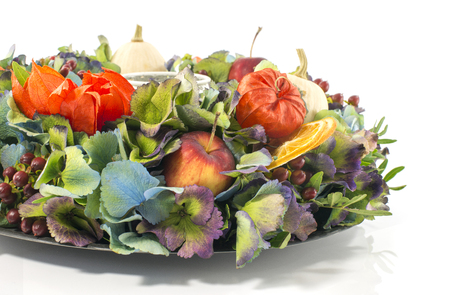 dried flower arrangement: autumn flower arrangement garland with dried fruit and flowers as present or decoration