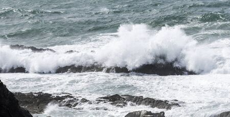big waves: big waves splashes over the rocks in the ocean Stock Photo