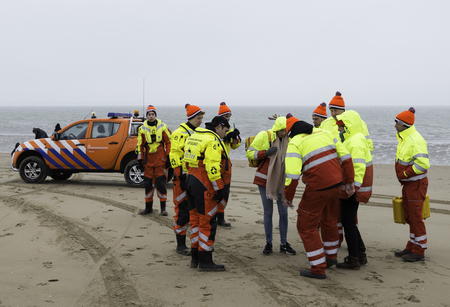 strat: ROCKANJE,NETHERLANDS - JANUARI 1: lifeguard standby for the traditional new years dive on Januari 01, 2017. New years dive is a traditon  to strat the new year Editorial