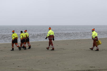 traditon: ROCKANJE,NETHERLANDS - JANUARI 1: lifeguard standby for the traditional new years dive on Januari 01, 2017. New years dive is a traditon  to strat the new year Editorial