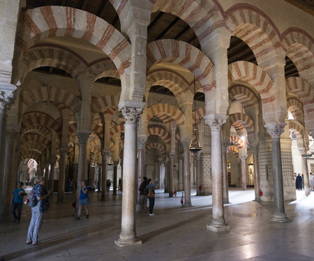 median: CORDOBA, SPAIN - 04 APRIL, 2017: unidentified tourists explore at Madinat al-Zahra in Cordoba on 04 april 2017, the median , Spain, the Medina houses a catherdral insite the big mosque