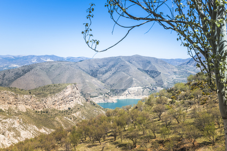 sierra nevada: blue lake and hills in the sierra nevada in andalusia spain in summer