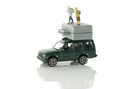 time for walking vacation with car and suitcase and puppet toy older people Stock Photo