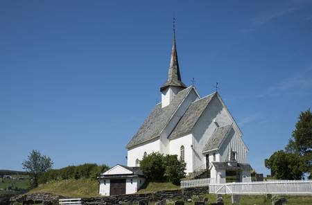 Europe Norway Ulnes  church along lakeshore in central Norway