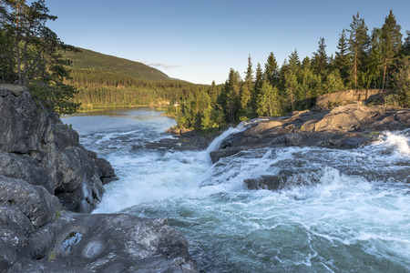waterfall in norway near the jotunheimen national park in the villag Leira