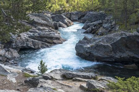 waterfall in norway near the jotunheimen national park in the village Leira near jotunheimen