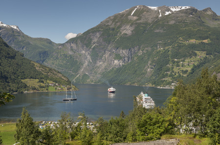 camping sailing boat and cruis ship in the famous geiranger fjord in norway