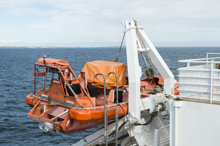 lifeboat on a cruise ship on the sea