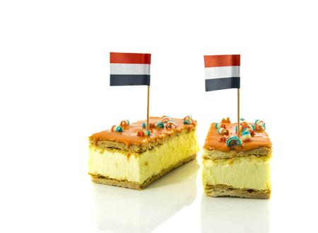 two orange tompouce with the dutch flag Stockfoto