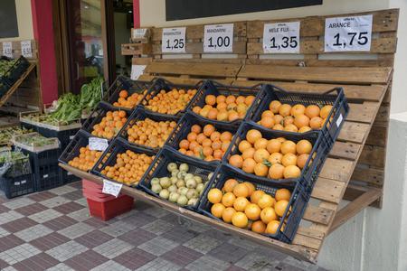 grocery stall on sardinia with orange fruit