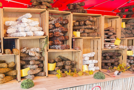 Malmedy,Belgium,15-august-2018: a market stall with various types of hard sausage, neatly displayed in wooden crates,the sausage are a specialty from belgian ardennes Stock fotó